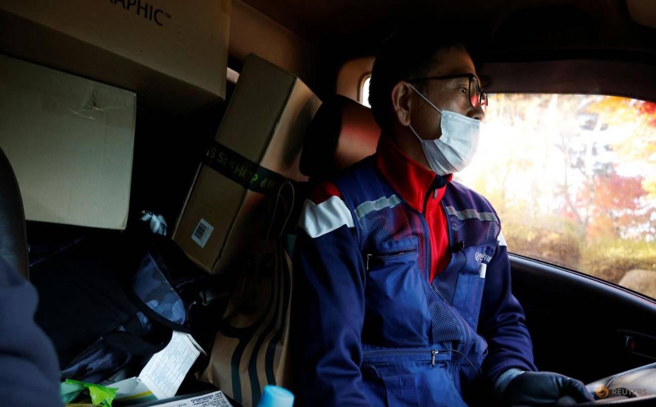 Thảm cảnh những nhân viên giao hàng Hàn Quốc: Bán mạng vì miếng ăn thời đại dịch - Ảnh 1.