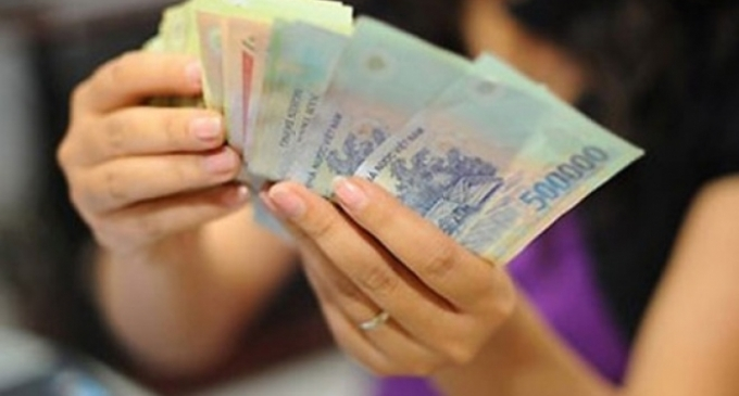 Tiền gửi vào ngân hàng giảm kỷ lục, tiền đang 'chảy' vào đâu? - Ảnh 1.